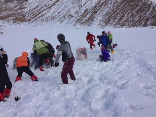 Iranian men women having a snow ball fight game in Lavasan Tehran Iran